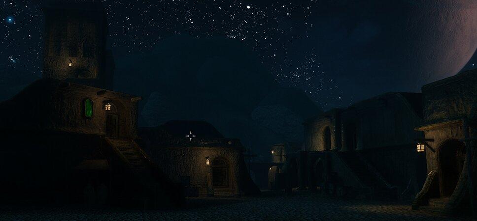 Unter einem nächtlichen Sternenhimmel stehen einige kleine Häuser aus Lehm.