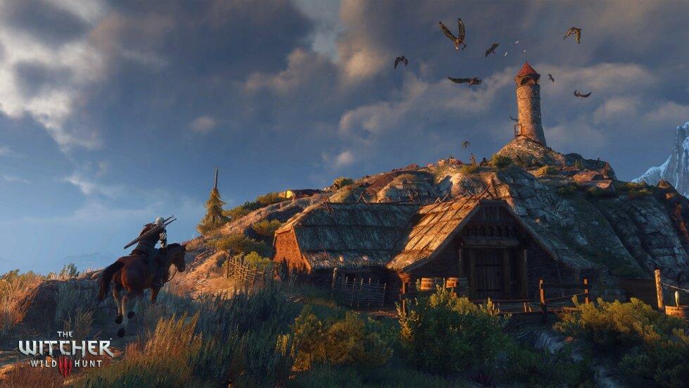 Ein Dorf auf einem Hügel, vor blauem Himmel